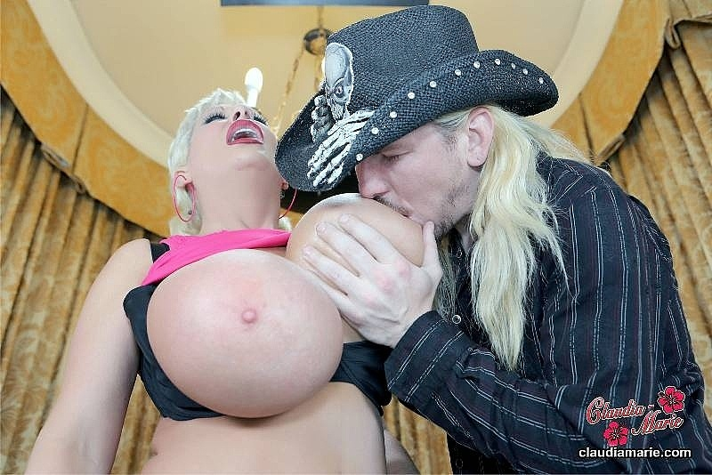 Cowboy sucking Claudia Marie's giant fake udders