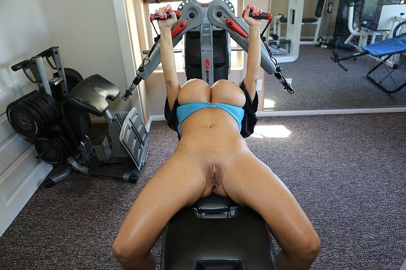 Big tit whore Claudia Marie straining to lift weight in the gym